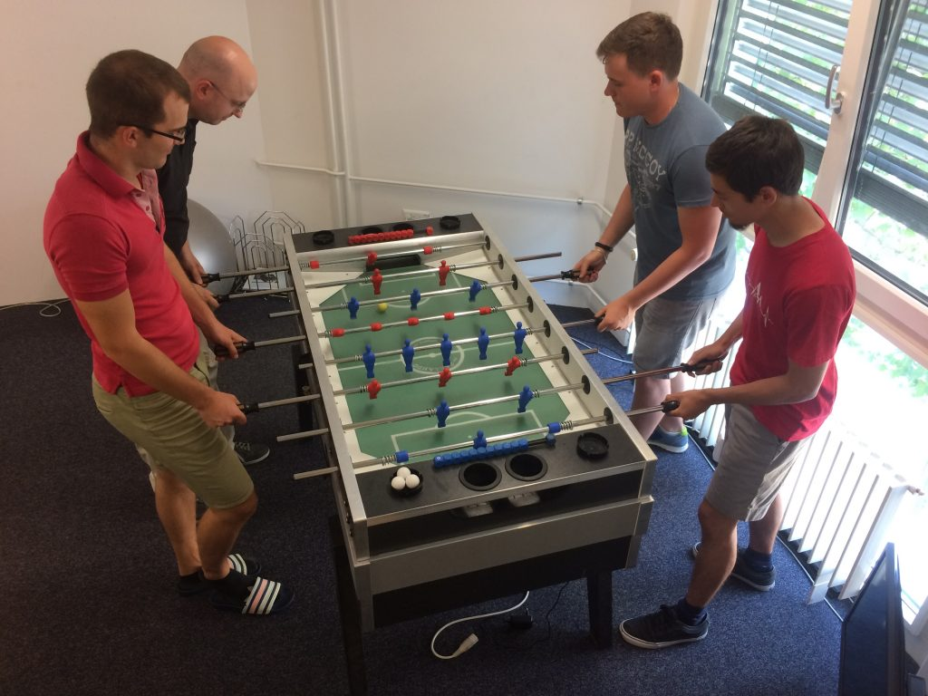 insign team playing table soccer